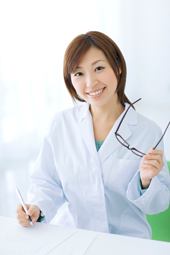 Woman in lab coat doing research